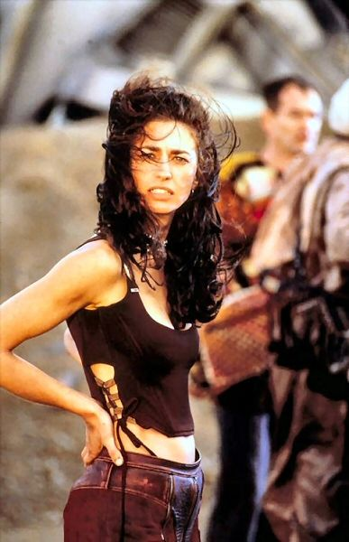 "Claudia Black as Sharon Montgomery ""the prospector"" in Pitch Black. Another woman with an amazing body! She had a small role and she should have stayed down and not died in such spectacular fashion. However, prior to that she was strong and beautiful and rather more intriguing than the female lead. I would love to read an entire book or see an entire movie focused on her Pitch Black prospector character."