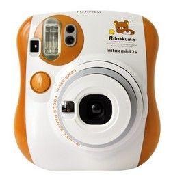 Fuji Rilakkuma Polaroid Camera I want the one in pink accents (http://www.fujifilm.com/products/instant_photo/cameras/instax_mini_7s/)