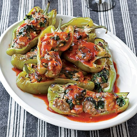 Spinach-and-Sausage-Stuffed Peppers | A fast, easy homemade pimiento spread adds a little kick to the gooey cheddar filling in this clever version of grilled ham-and-cheese sandwiches.
