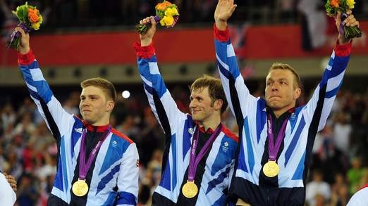 Sir Chris Hoy leads GB to cycling gold in men's team sprint with Philip Hindes and Jason Kenny.