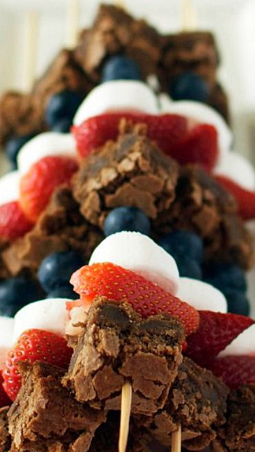 Red, White and Blue Fruit and Brownie Skewers Sams club has those cute mini brownies that would be perfect just for these kabobs!