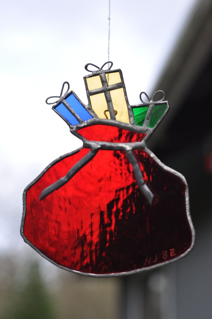 https://www.etsy.com/listing/492329951/stained-glass-ornament-bag-of-presents?ref=shop_home_active_1 #cHRISTMAS #SANTA #bag #toys #gifts #ornament #red #green #vintage #stained #glass #collectible