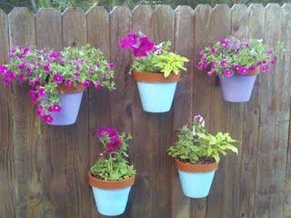 Flower pots on fence - so cute!!: Backyard Ideas, Garden Ideas, Diy Fence, Backyard Fences, Outdoor, Gardening, Flower Pots, Fence Flower, Mom