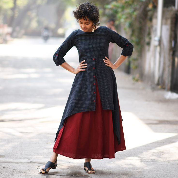 This Maroon and black khadi dobby dress speaks volume about classic fashion while blending chic and comfort perfectly. The cut of this dress will accentuate your body comfortably and fabrics will provide you unmatched comfort. Style tip- pair of Kolhapuri sandals and silver chunk jewellery will make you style diva that you are! Size information (Garment Measurements): Small (S): Shoulder 13.5'', Bust 35'', Waist 33'', Length 51'', Sleeve Length 17'&#3...