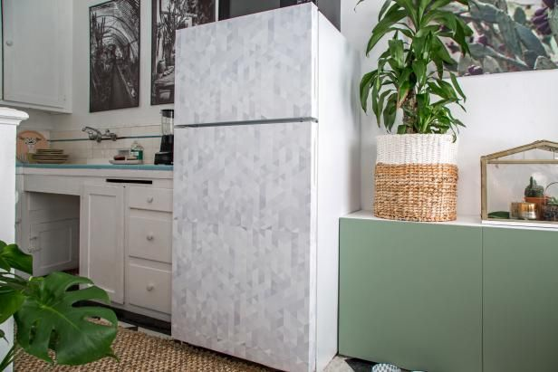 DIY Network shares ideas for decorating a kitchen in a rental apartment, including how to wallpaper a refrigerator.
