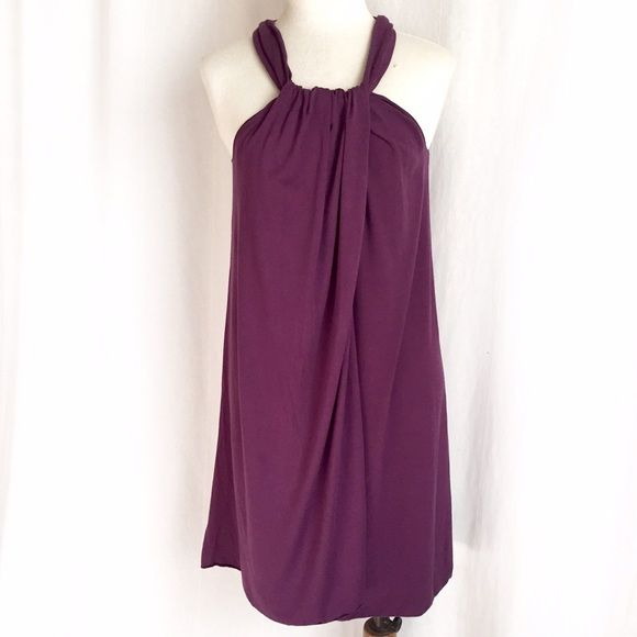 "Max Studio Halter Neck Trapeze Dress Swingy, stretchy grape colored trapeze dress. Smooth jersey knit with a front overlay/flap to give it a wrap effect. Halter neck. 92% viscose; 8% spandex. Machine wash. Size Medium (can accommodate various sizes due to stretch). Bust: 17"" flat across, unstretched will stretch comfortably to 19.5"" flat across. Length: 36"". Worn once and in EUC. Thanks for looking! Max Studio Dresses"
