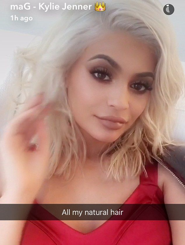 All natural: The star - who normally wears wigs when she wants a new look - admired her locks in video clips she shared on Snapchat