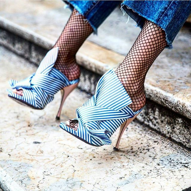 Fish nets are currently enjoying a renaissance and teamed with frayed jeans and these OTM mules, how can you lose? Autumn winter outfits to die for.