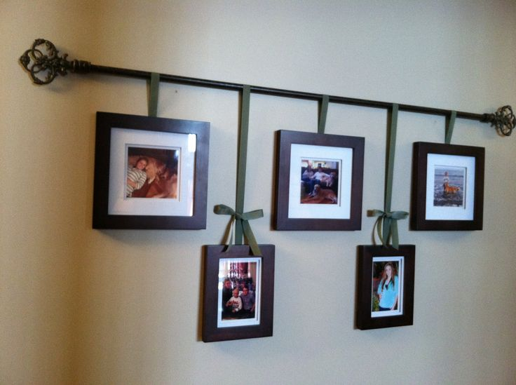 My version of a curtain rod photo hanger. Perfect for our long hallway!