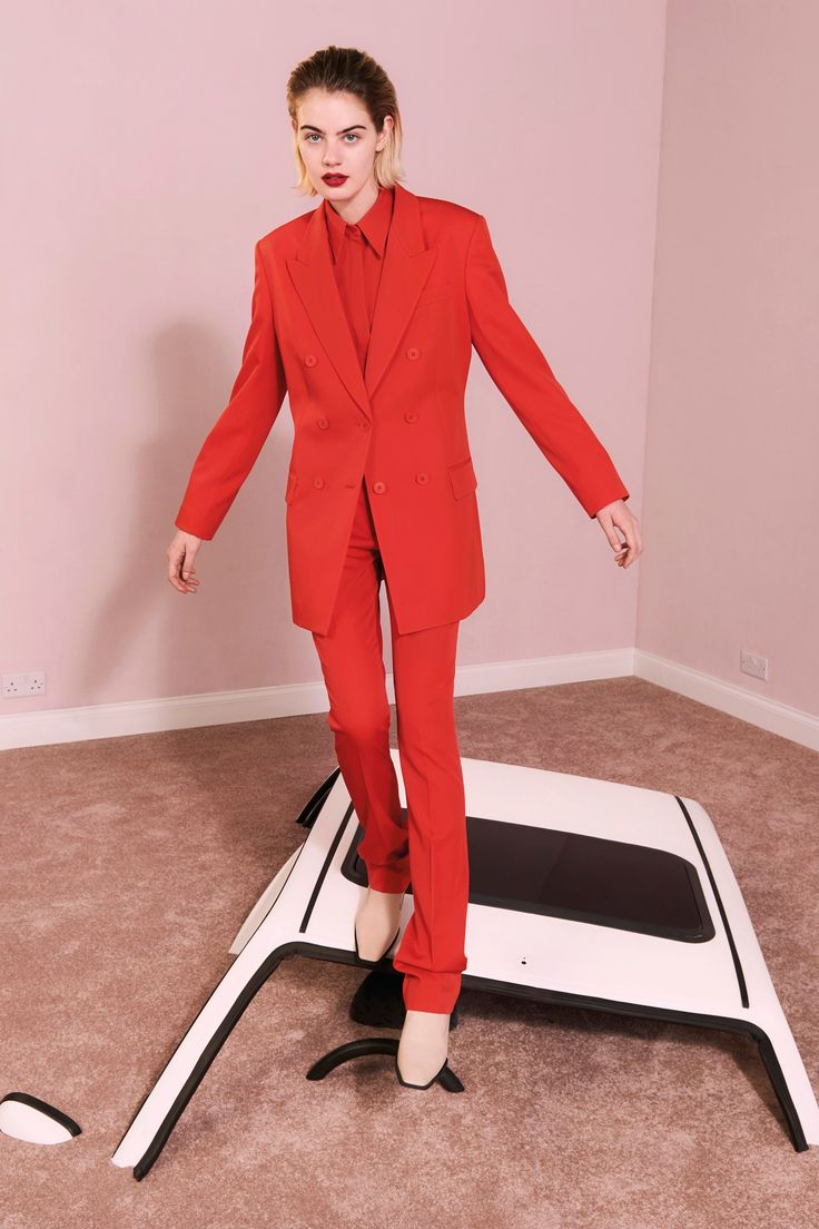 Laura Baxter. 4/13/17. This Stella McCartney Pre-Fall 2017 takes inspiration from the power suits for women of the 1980s. With a record amount of women entering the workplace, women wanted to be seen as being as equal and as able as men. The suit, along with its strong shoulders, promotes a message of competence and status to society.