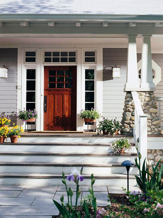 Love the stairs leading to front door. Like the colour of the cladding against the white trim. Would do different door and windows around.