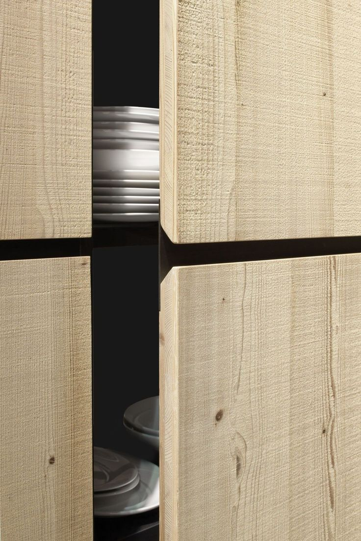 Cabinet - cupboard - detail - wooden front - recessed handle - angled handle - black steel