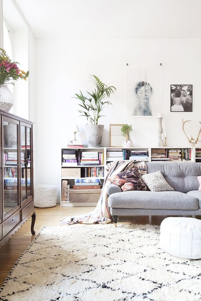 Not all bookshelves have to tower over your living room, instead opt for a low and wide shelving unit
