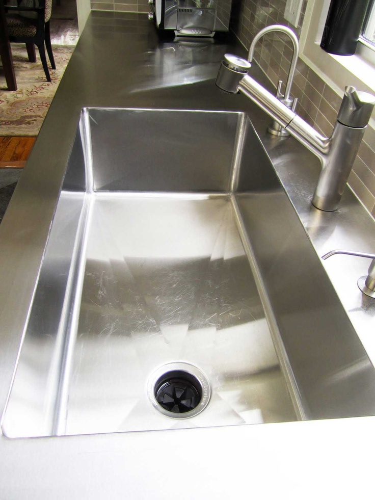 Stainless steel kitchen sink and table top