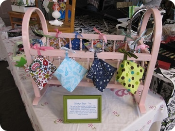 Craft Fair Display ideas.. Baby crib to hang bib on and fill inside with burp…