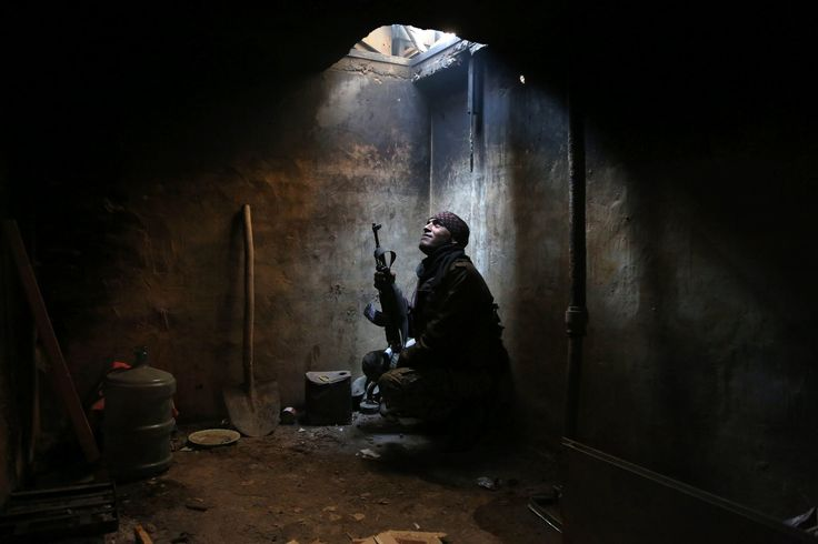 ARBEEN, NEAR DAMASCUS, SYRIA 1/29/2016 An antigovernment fighter hid in a rebel-controlled area on the outskirts of the Syrian capital. The country has been in conflict for nearly six years. Amer Almohibany/Agence France-Presse — Getty Images