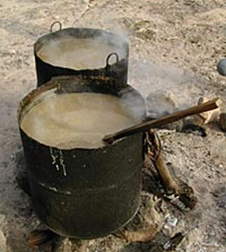 Boiling cauldrons of ground corn -- one of the first steps in creating the corn beer called tesquino
