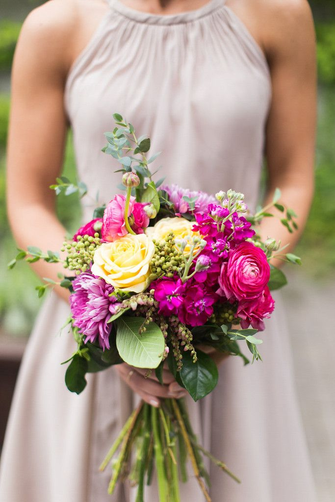 Latte bridesmaid dress with a vibrant purple and pink bouquet. | Floral Graffiti Inspiration at The Big Fake Wedding