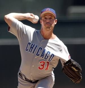 Chicago Cubs pitcher Greg Maddux en route to his 300th career win, in a baseball game against the San Francisco Giants, in San Francisco. The Chicago Cubs are retiring the No. 31 worn by both Ferguson Jenkins and Greg Maddux.