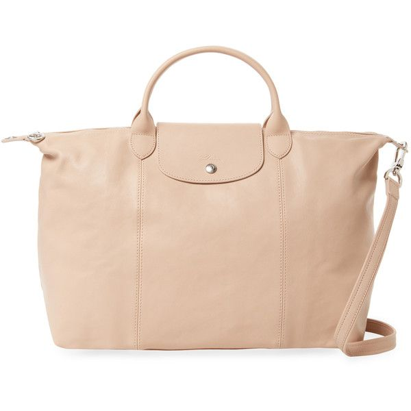 Longchamp Le Pliage Cuir Large Tote - Cream/Tan (1,795 MYR) ❤ liked on Polyvore featuring bags, handbags, tote bags, foldable tote, tan leather tote, pink leather purse, longchamp tote bag and pink tote bags