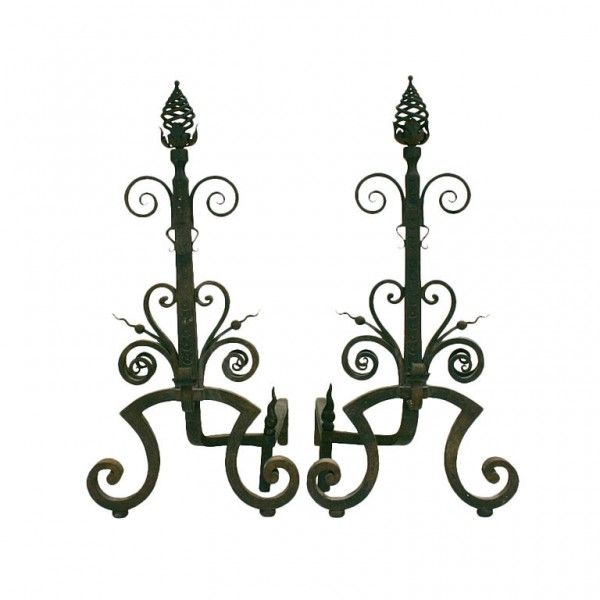 Large Pair of Andirons - having spiral coil finials above open metal leaves,the bodies with a series of scrolls resting on wide curled feet