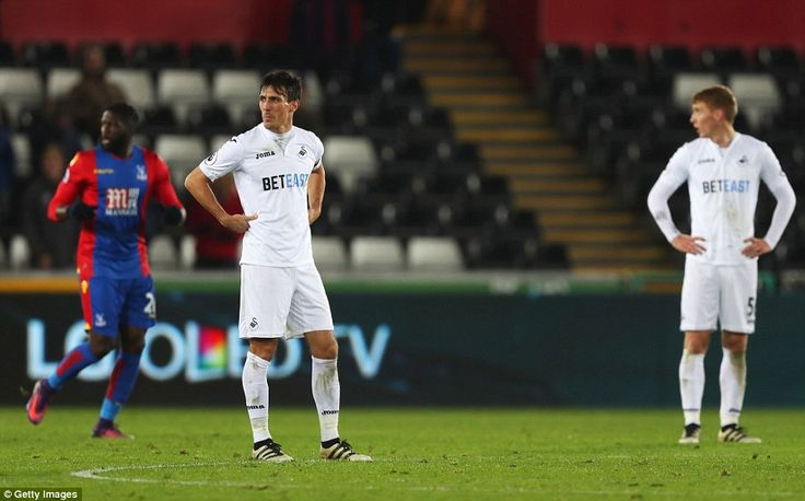 Jack Cork looks dejected after scoring an own-goal to level the game at 3-3 before the late drama unfolded in Wales
