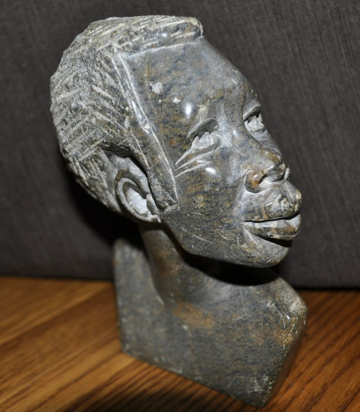 Soapstone carving of an young man. | Soapstone carvings | Pinterest