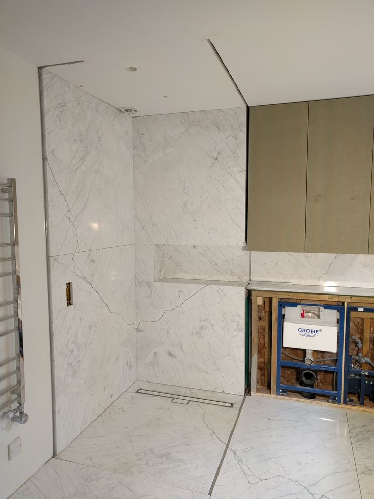 Carrara Marble shower enclosure formed at our  Chislehurst Project