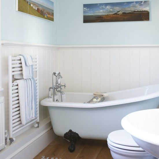 Small pale blue bathroom The combination of white-painted wood panelling and pale blue walls makes this small, beach house bathroom feel deceptively large and open. The slipper roll-top bath adds a touch of elegance to the simple scheme.
