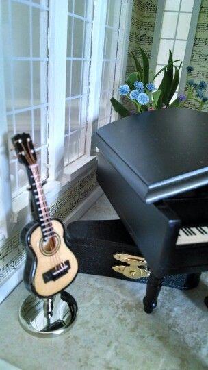 Miniature guitar in 1:12th scale.