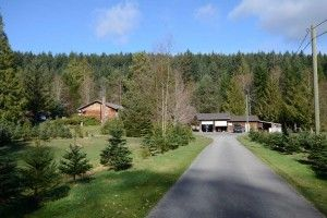 HOME ON 25 ACREAGES 12338 Hwy 101 Powell River BC 2 properties - 2 separate titles, sold together. 1st property is level south facing 12.95 acres, 2300 sq. ft. home with 2 bdrms, large rec , oak kitchen, covered front deck & rear patio. Double garage with workshop, storage shed, private gardens & beautiful large pond. 2nd property is 12.5 level acres with great soil, separate septic & water to old modular home site. Operating as a Christmas tree farm, equipment to operate is optional.