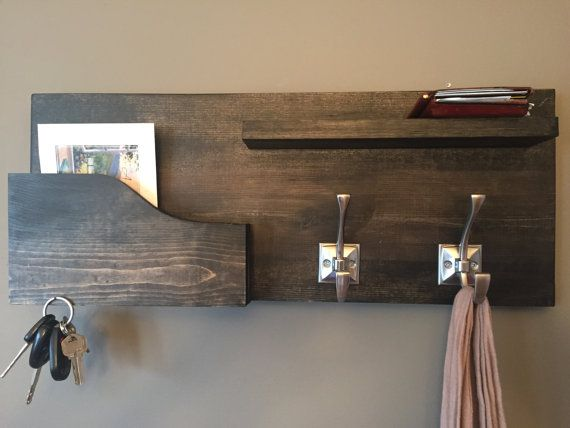 This coat rack / mail organizer / magnetic key holder is handmade and a great way to add rustic charm with a modern feel to your entryway or