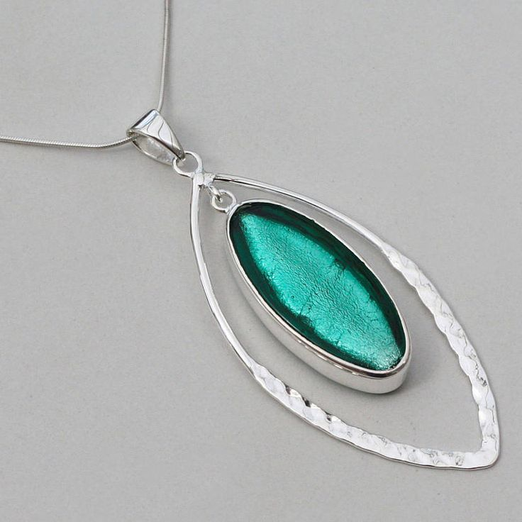 murano glass & silver hammered elipse pendant by claudette worters | notonthehighstreet.com