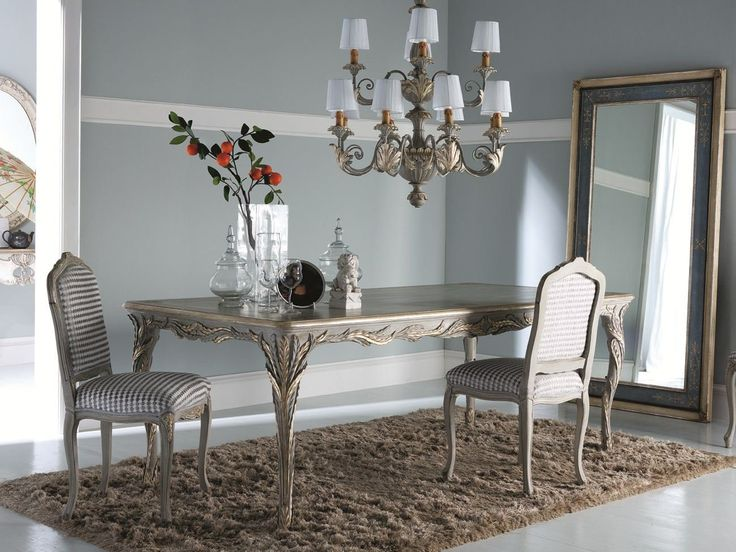 Solid carved wood furniture finished by hand by expert artisans, an Italian tradition.