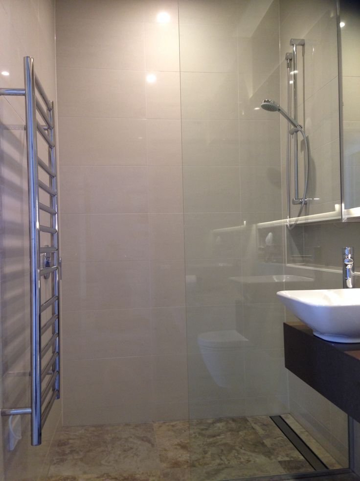 A new guest ensuite, with a niche shelf running the length of the bathroom.