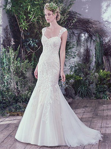 Maggie Sottero - GIA, Lace and sequins are artfully placed atop tulle in this feminine fit and flare wedding dress. Finished with a soft sweetheart neckline and corset closure. Lace cap-sleeves sold separately.