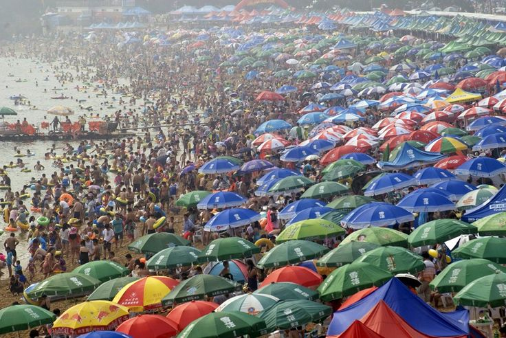 People crowd on a beach in Dalian, Liaoning province, to escape the summer heat.