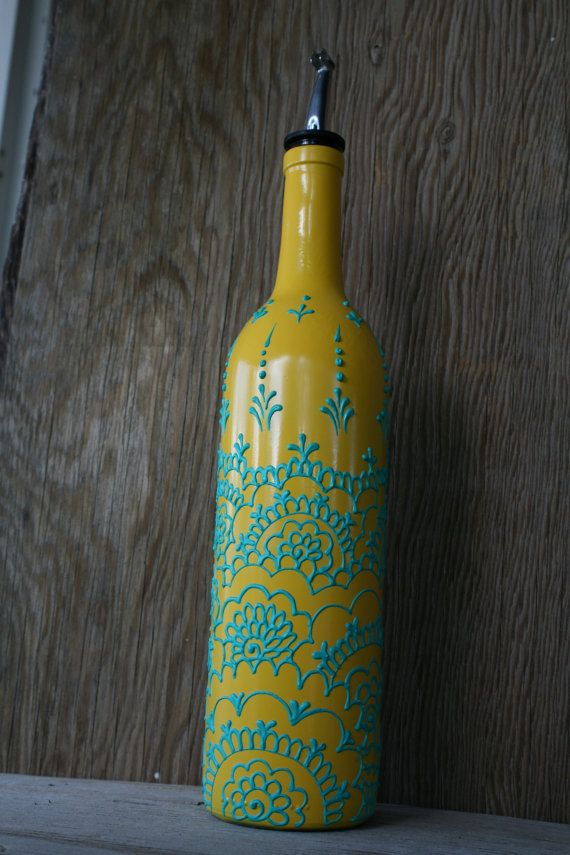 Hand Painted Wine bottle Olive Oil Pourer, Sunny Yellow and Aqua Green, Moroccan style design, Olive Oil Dispenser Add some color to your kitchen! Up cycled wine bottles make great olive oil and vinegar dispensers. Ive thoroughly scrubbed and washed this wine bottle, painted a Moroccan style design to the outside of the bottle, and added an olive oil spout. The bottle can be gently hand washed. Details- *Wine bottle measures approximately 12 inches high. *Sunny Yellow bottle with aqua…