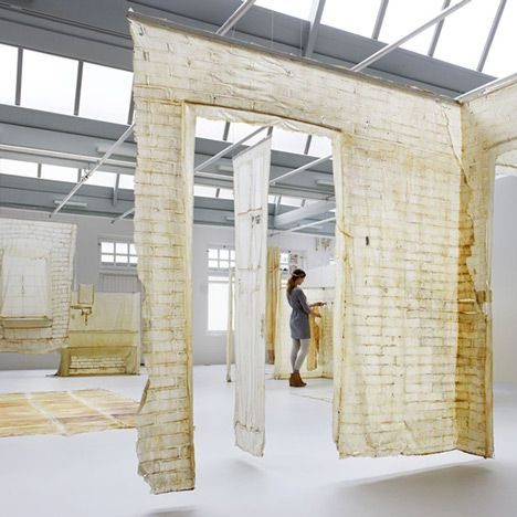 Shrouds of latex cast from derelict buildings hang in this installation by Amsterdam design studio KNOL Ontwerp, forming ghostly recreations...