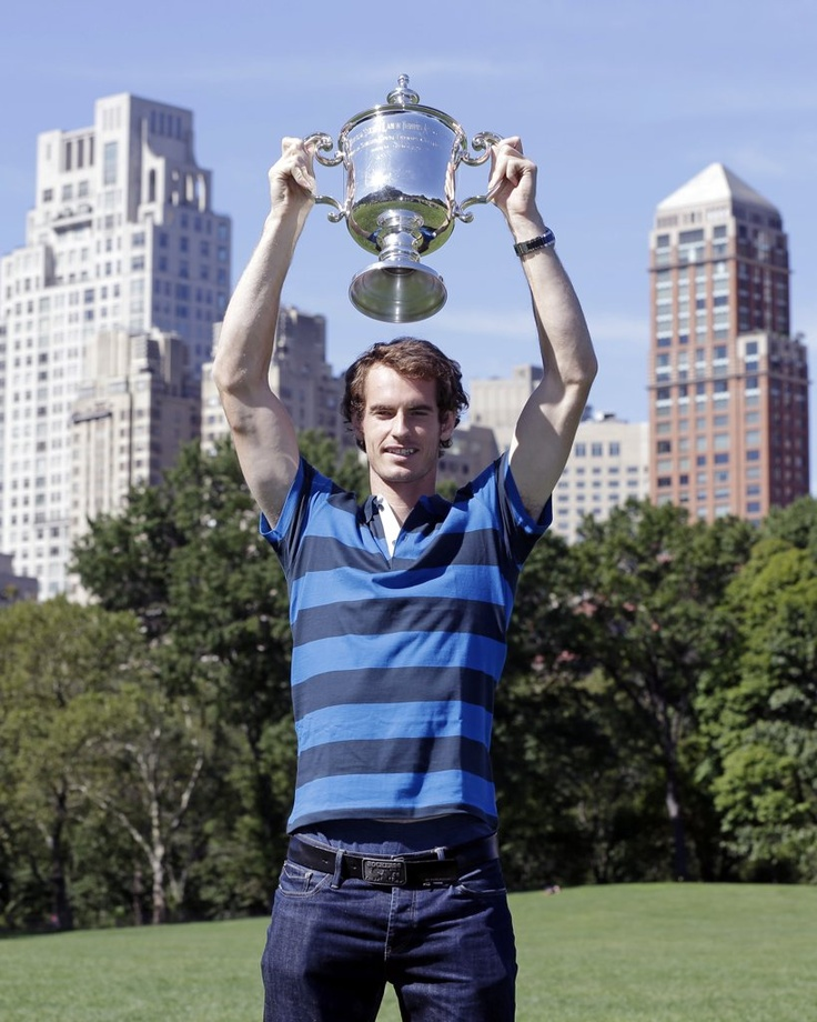 2012 US Open champ Andy Murray holding up his trophy in Central Park