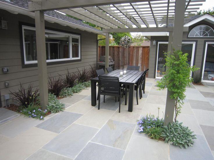 Contemporary pergola over dining area & contemporary paving