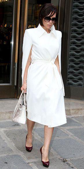 Victoria Beckham in Hermès cape coat & bag and Louboutin pumps, 2009