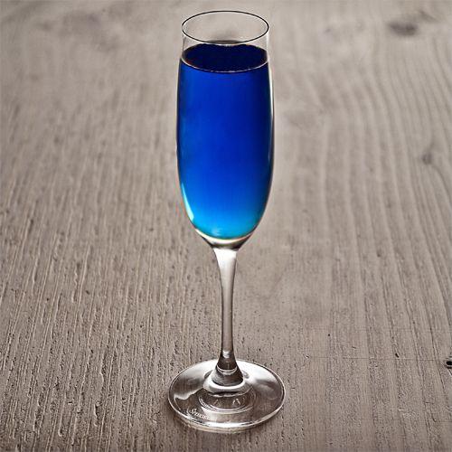 Diamond Blue cocktail recipe - .75 oz Hendrick's Gin .75 oz Crème de violette .25 oz Blue Curaçao 1 Lemon wedge 3 oz Champagne click for the rest