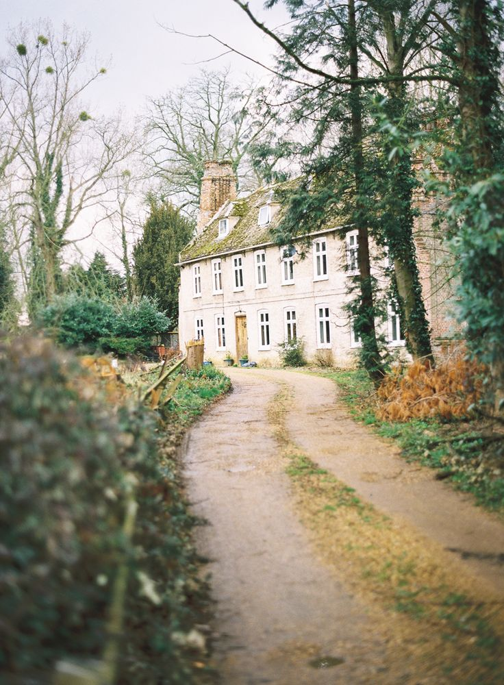 Country house with rambling dirt driveway