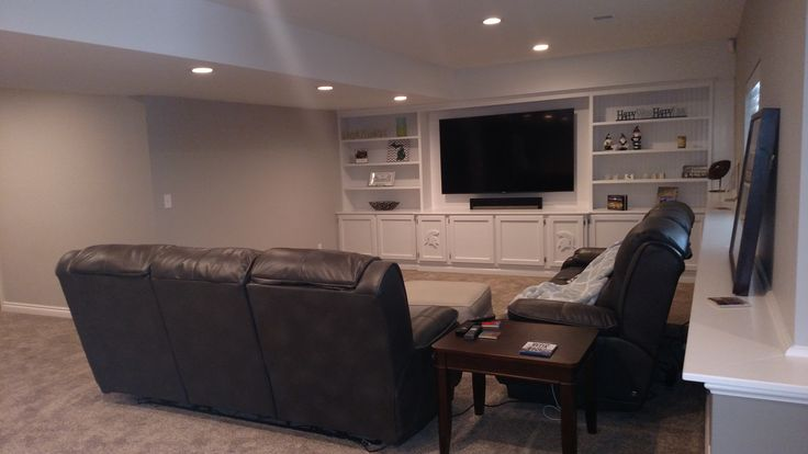 Finished Basement with Sports Theme. Custom trimwork.