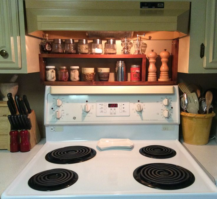 """Spice Rack DIY. Made of 1""""x4"""" spruce. Stained and varathaned, and fits between the cabinets. I drilled 2 holes on each side of the cupboard and hung the rack just above the stove with 4 stainless bolts for easy removal later."""