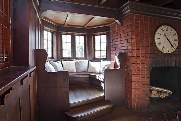 A reading nook located in the living room. Built in 1916, the Arts and Crafts-style home has many unique features. Photo: Courtesy Of Obeo