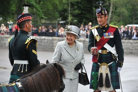 HM The Queen arrives in Balmoral for her holiday. This year's Guard of Honour is comprised of A (Grenadier) Company of The Black Watch, 3rd Battalion The Royal Regiment of Scotland, commanded by Maj Robert Hedderwick. The Mascot of The Royal Regiment of Scotland - the Shetland Pony, Cruachan III with his handler Cpl Joe Walker. Cruachan, aged 23, will retire after his part in this year's Royal Edinburgh Military Tattoo and will go to live in luxurious retirement in Edinburgh's Redford…