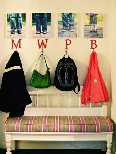 Give each family member a dedicated hook for coats and bags to keep the entry space tidy. Personalize it with photos of each person or their with initials.