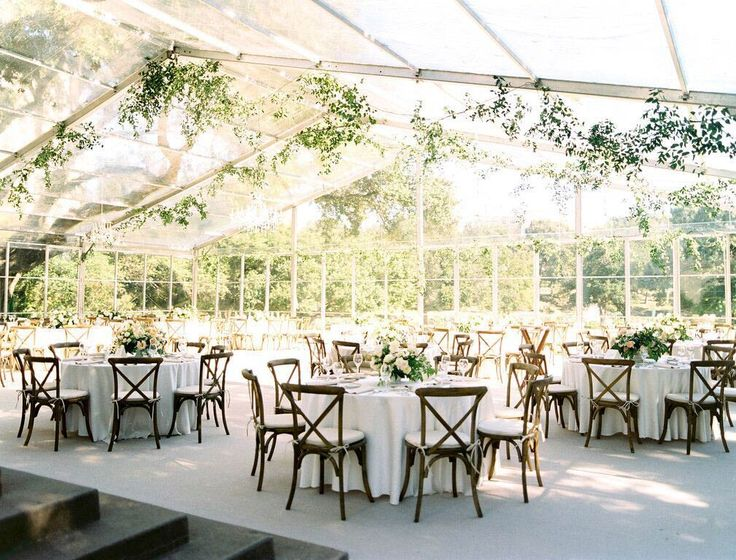 Arlington Hall wedding reception clear tent off back patio with carpeting and cross back chairs